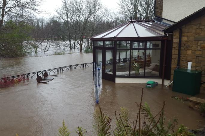 Back of Robson's house showing flood level against the conservatory