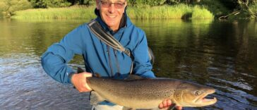 Robson Green lands an 11lb trout in the River Tyne