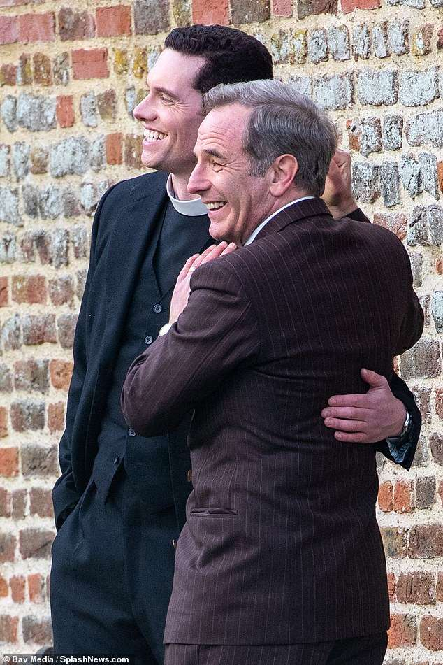 A laugh a minute: Robson Green and Tom Brittney looked to be in great spirits filming scenes for the sixth series of ITV crime drama Grantchester on Friday